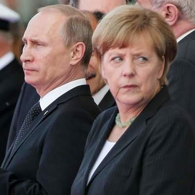 Путин пожаловался Меркель на Украину