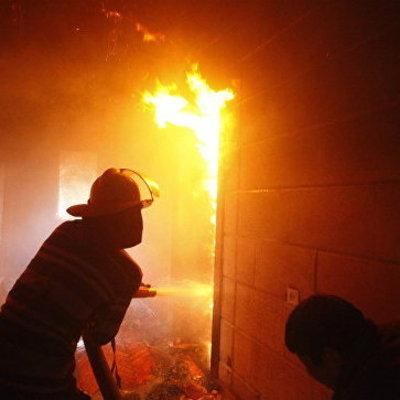 9-летний мальчик вынес из огня двух братьев и сестру